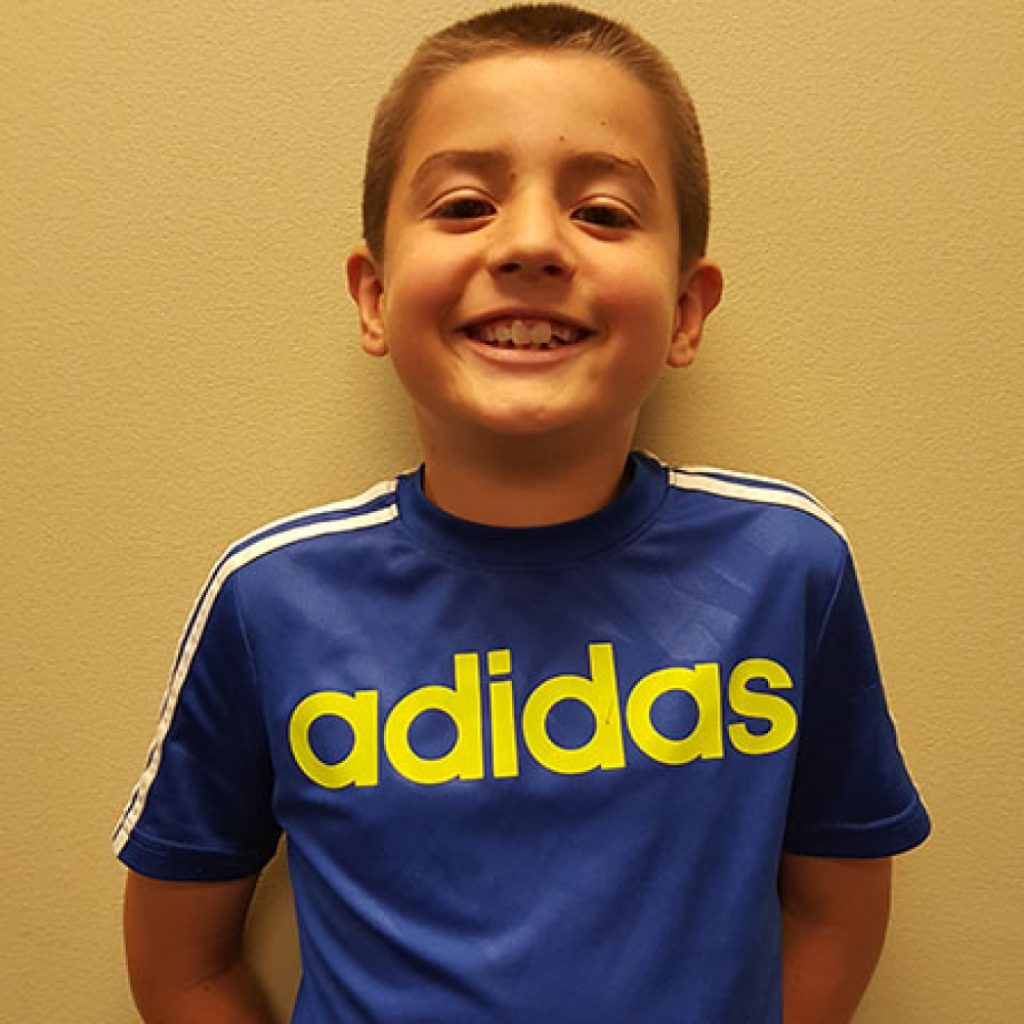 young happy student with soccer shirt